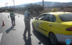 الشرطة تضبط مركبة بحمولة زائدة بلغت 7 ركاب في الخليل