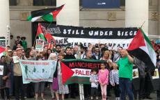 جبهة النضال الشعبي في بريطانيا تشارك في مسيرة الشموع حداداً على أرواح شهداء غزة