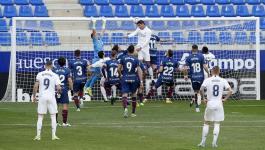 ريال مدريد يفلت من كمين هويسكا