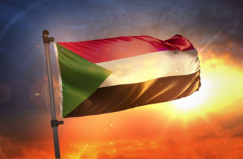 videoblocks-sudan-flag-backlit-at-beautiful-sunrise-loop-slow-motion-4k_blx8kr6-w_thumbnail-full04.png