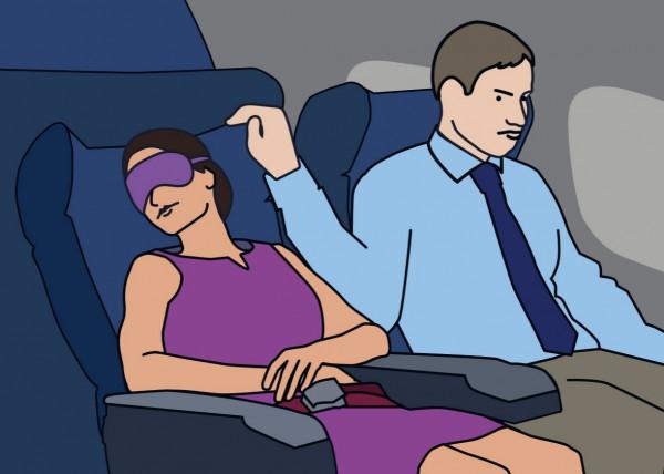 هندي يهتك عرض امرأة جالسة في الطائرة قربه وزوجته بجانبه